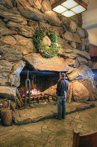 jonathan warming by the fireplace at the grove park inn in