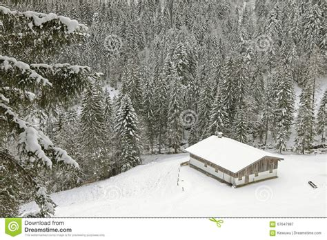 wooden russian house in winter covered with snow stock old wooden barn in the mountain covered with snow in the