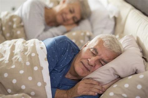 adults in bed pink noise boosts deep sleep memory for older adults