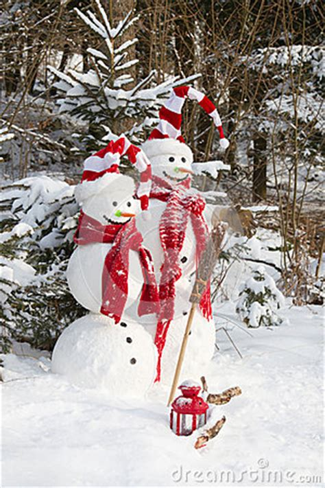 snowman couple  love christmas outdoor decoration  snow royalty  stock photo image
