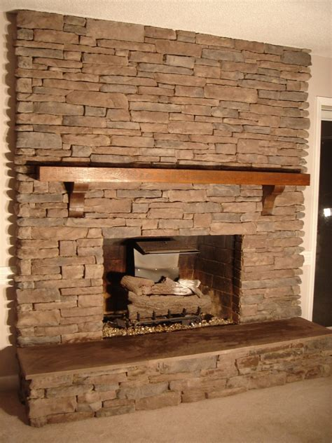stone wall fireplace built in fireplace living room shelves with white wooden