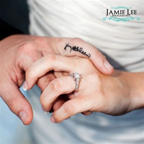 tattoo finger wedding wedding ring tattoo name tattooed onto finger jamie lee