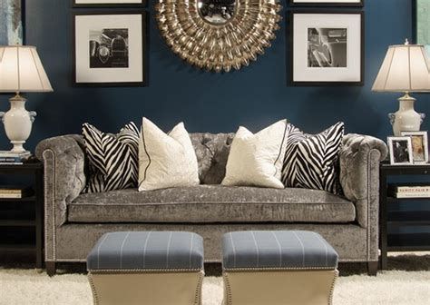 Dark blue walls, black and white accents, Gray couch