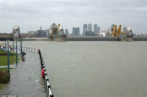 thames river tides uk weather sees britain battered by extreme high tides