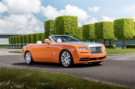 roll royce orange rolls royce featured in neiman book