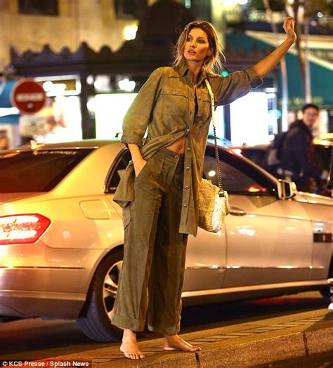 Gisele Bundchen Ysl Besace Purse Hail A Cab In Nyc by Gisele Bundchen Flashes Midriff Hailing A Cab During