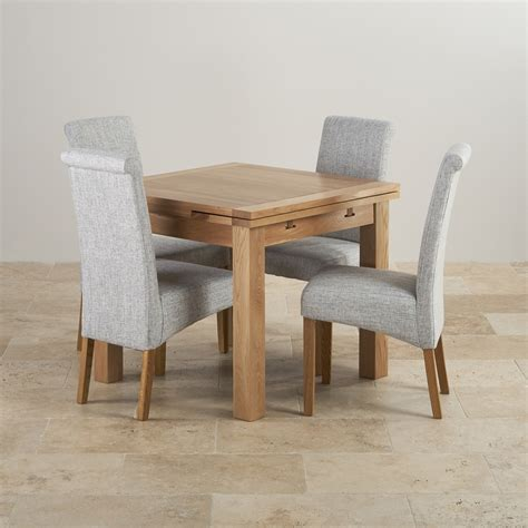glass and oak dining table and chairs dorset oak 3ft dining table with 4 grey fabric chairs