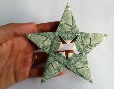 Origami Made With Money - origami santa claus and