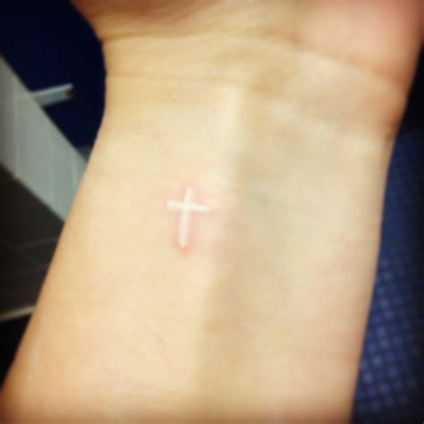 white ink cross tattoos i and want