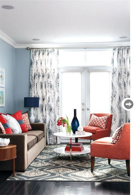 dark brown couch  grey blue wall  navy accents