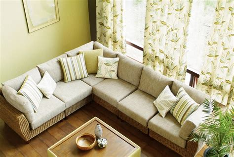 Ordinary Leather Sofa For Small Living Room #6: Designs-of-sofas-for-living-room-white-sofa-cushions-wooden-table-frame-small-plants-curtain-window.jpg