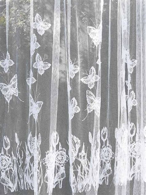 butterfly sheer curtain panels combine embroidery designs to create this beautiful sheer