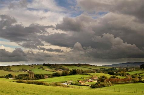 New Farmhouse Plans farm house in rural landscape photograph by david yates