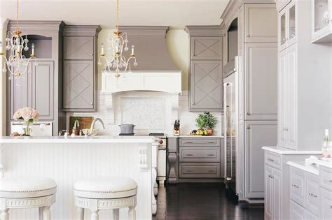 this inviting kitchen features flat front white cabinets beautiful lovely kitchen features a white flat front