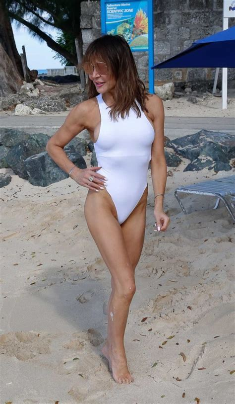 lizzie cundy   white swimsuit   beach  barbados celeb donut