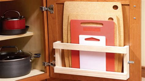 Cutting Kitchen Cabinets | store cutting boards in your cabinets with a magazine rack
