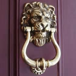 aged brass s door knocker