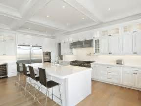 white kitchens with islands white kitchen island with wood barstools