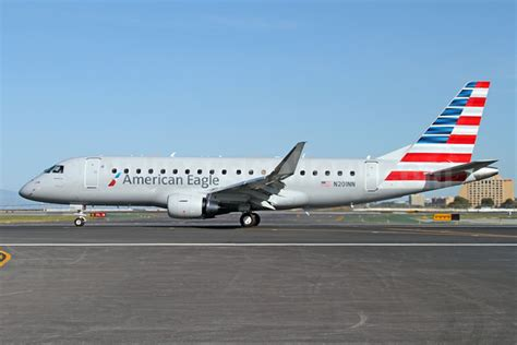 Original Jobb Minsk Kemeja Blue embraer and american airlines sign a contract for four