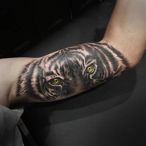 inner bicep tattoos 58 tiger tattoos ideas
