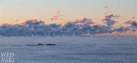 sea smoke tom moore rock engulfed in sea smoke marblehead ma