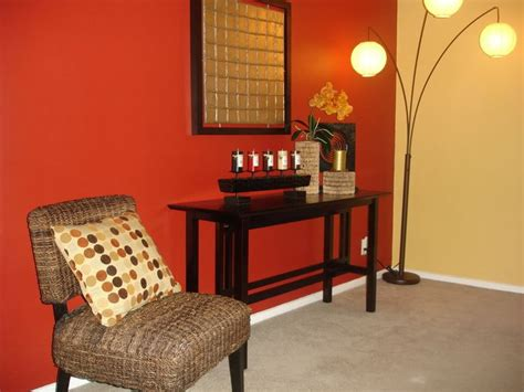 red accent wall living room focal point accent wall red wall warm tones basement
