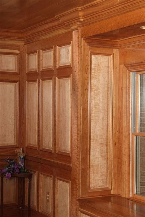 raised panel maple custom wall system with american cherry rail and stiles