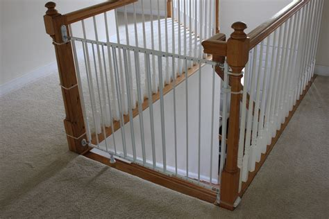 top of stairs banister baby gate installing a baby gate without drilling into a banister insourcelife