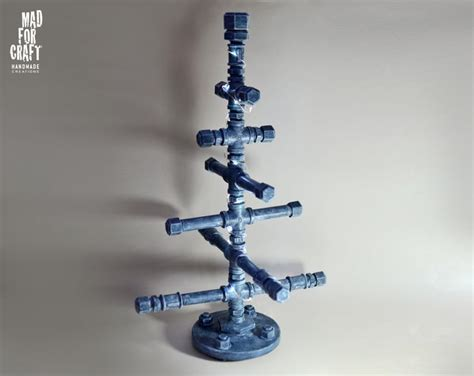 industrial style metal pipe christmas tree trees