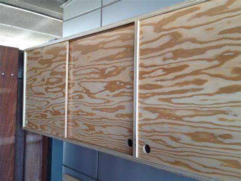sliding door plywood cabinet  roberto gil red hook