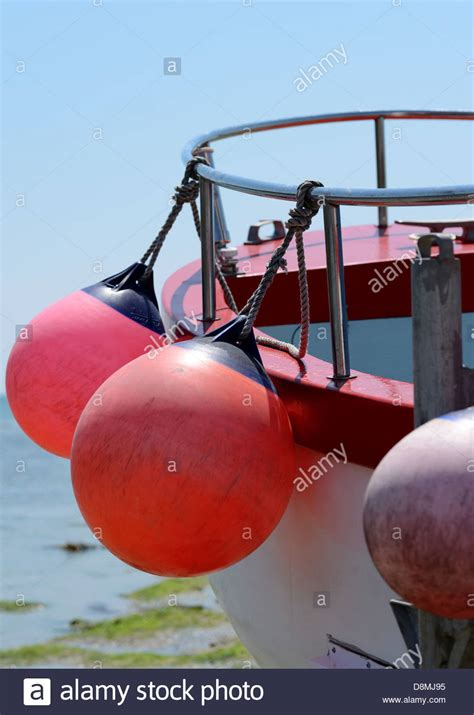 side of a fishing boat fishing bouys on the side of a fishing boat stock photo