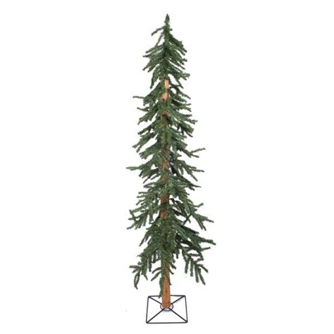 green alpine artificial christmas tree with wooden trunk
