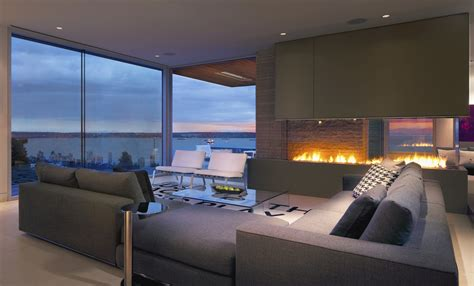 design house furniture vancouver living room with a view of the ocean and of the fire