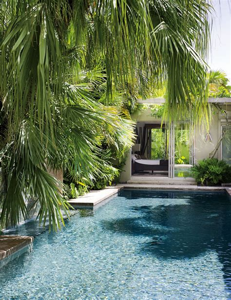 key west porch decorated with tropical accessories key exotic pool by malcolm james kutner inc by architectural