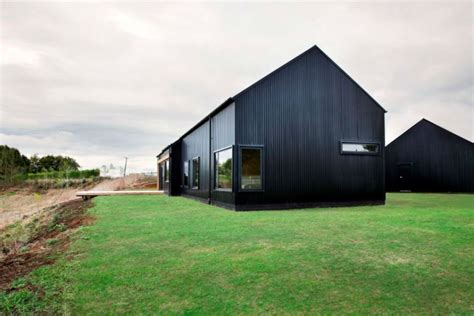 two barns house contemporary black barn in waikato wins national
