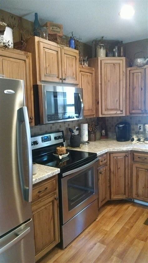 rustic knotty alder  black glaze kitchen cabinets