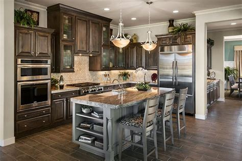 cabinets to go dearborn glass fronted cabinets and a contrasting island are memorable details in this kitchen new homes