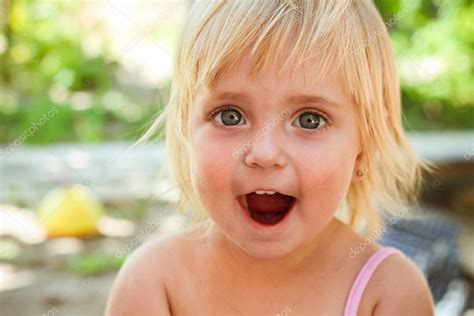 little girl mouth open little girl with open mouth the child screams with joy