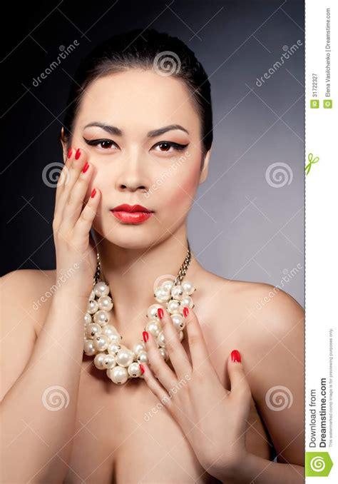 beautiful model models female people background portrait of a beautiful asian female model wearing pearl
