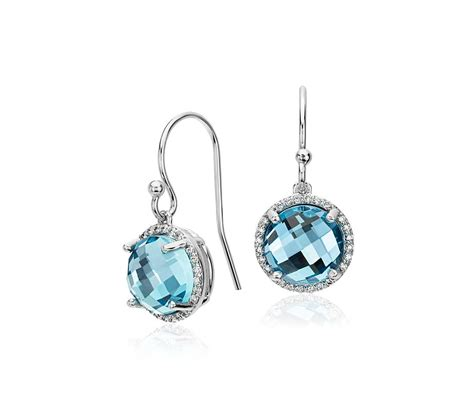 blue topaz and halo drop earrings in 14k white