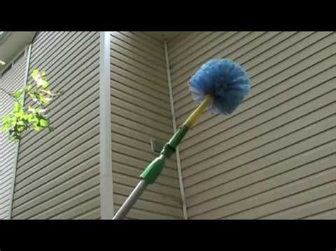 how to clean spider webs from house siding webster web remover demonstration on spider webs youtube