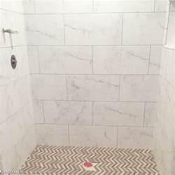 calcutta marble look tiles bathrooms pinterest