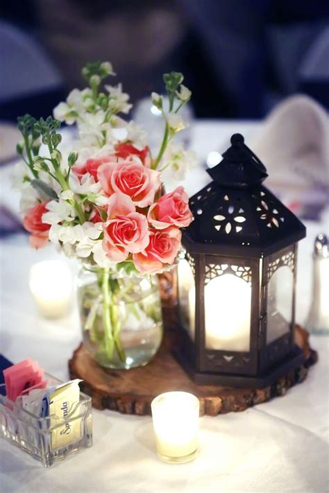 wedding centerpieces with flowers and lanterns 10 awesome lantern centerpieces the snapknot
