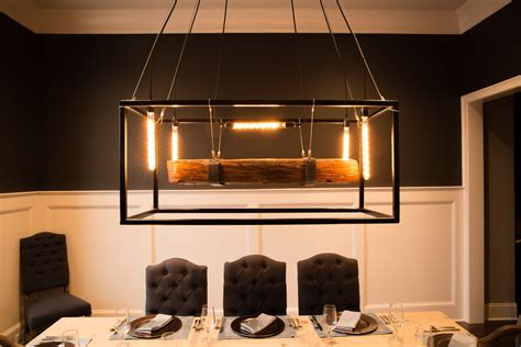 Amazing Edison Bulb Chandelier With Wood Table And Tufted Black Dining Chairs Also White
