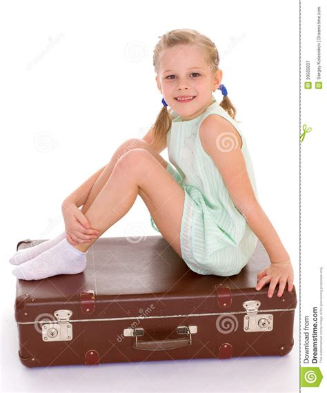 extra small girl little girl with a big and very old suitcase stock image