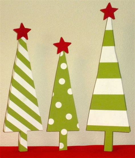 three painted wooden christmas trees