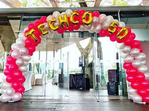 Foil balloon letters on balloon arch that balloons