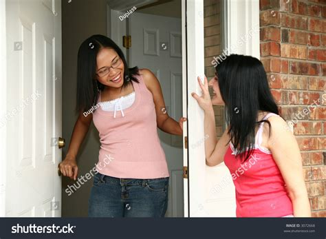 Answering The Door by Answering Door For Friend Stock Photo 3072668