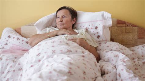 coughing in bedroom only ill senior woman coughing in bed stock footage video