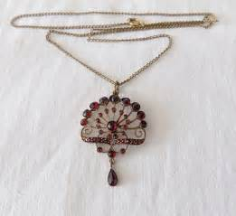 beautiful vintage necklace with pendant with garnet stones